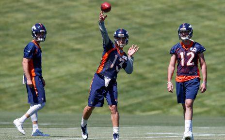 Denver Broncos quarterbacks Siemian and Lynch